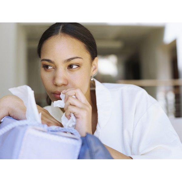 Woman holding tissues
