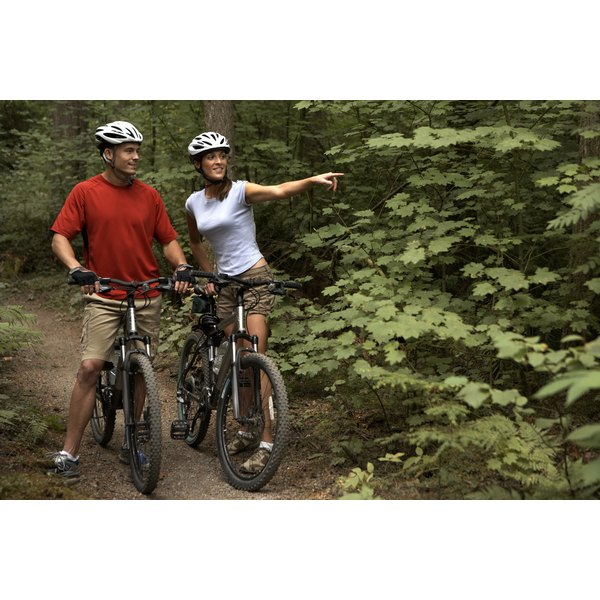 A man and woman are biking together.