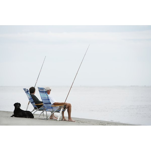 Two men fishing on the beach.