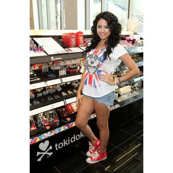 Singer Jasmine B. wears a pair of high-top Converse sneakers.
