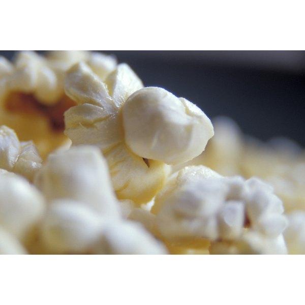 Season popcorn as soon as it pops so the starch absorbs more flavor.