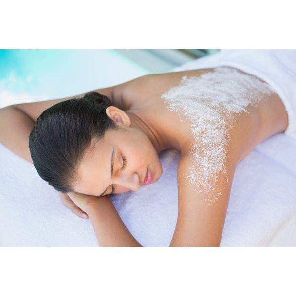 A woman having a sea salt treatment at a spa.