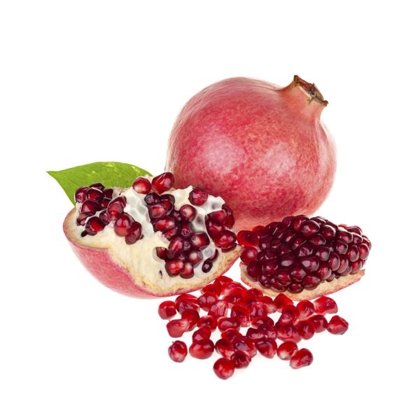 A pomegranate next to one cut open with some of its seeds out.