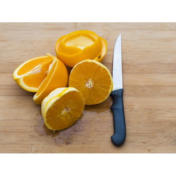 Sliced oranges on a cutting board.