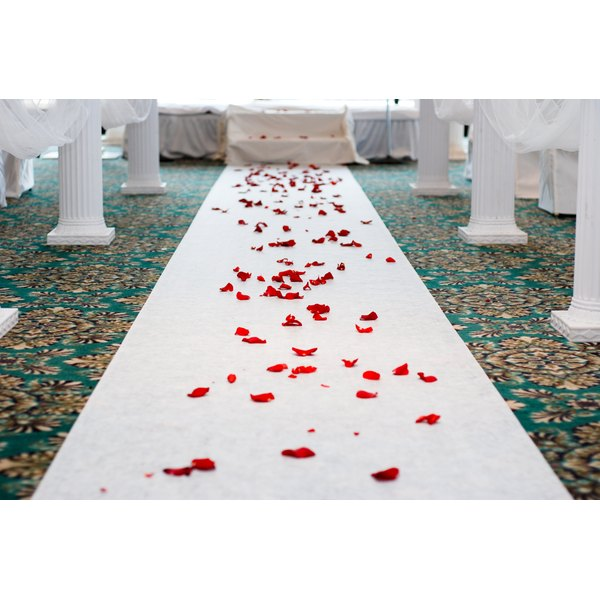 Wedding aisle covered in roses.