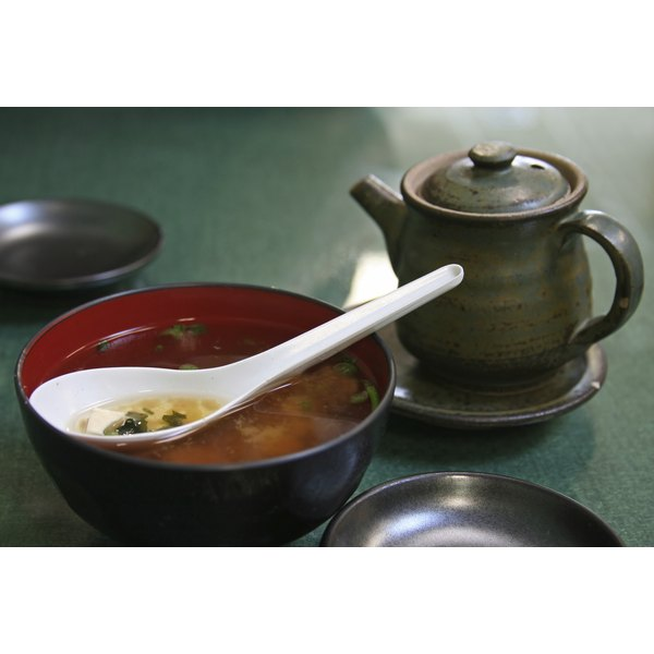 A bowl of miso soup on a restaurant table.