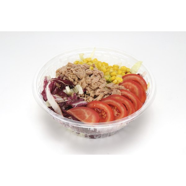 A small plastic bowl of tuna salad is ready for freezing.