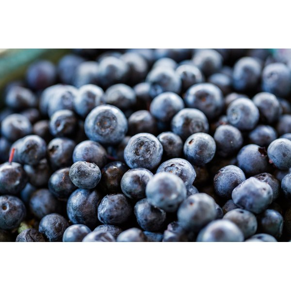 A close-up of blueberries for sale at a market.