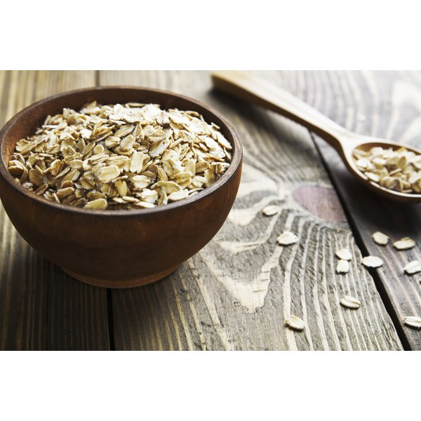 A bowl of oats on a wooden table.