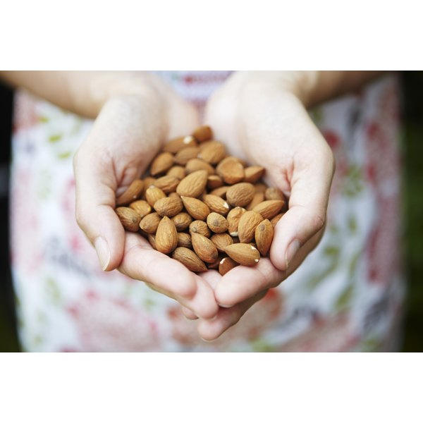 Woman's hands cupping almonds