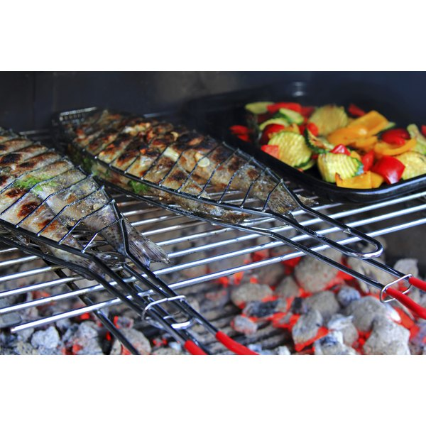 Fresh trout on the grill with vegetables.