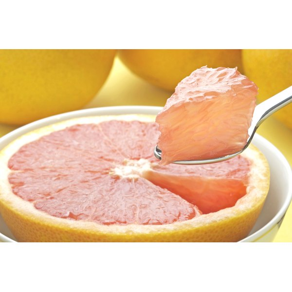 Spoon scooping a piece of grapefruit