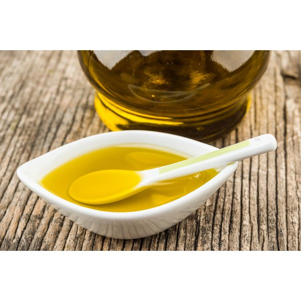 A spoon in a bowl of olive oil.