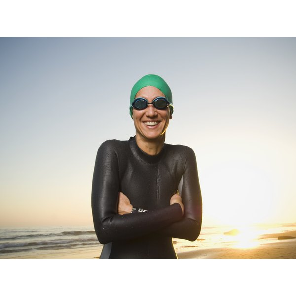 A triathlete is smiling in the sun.