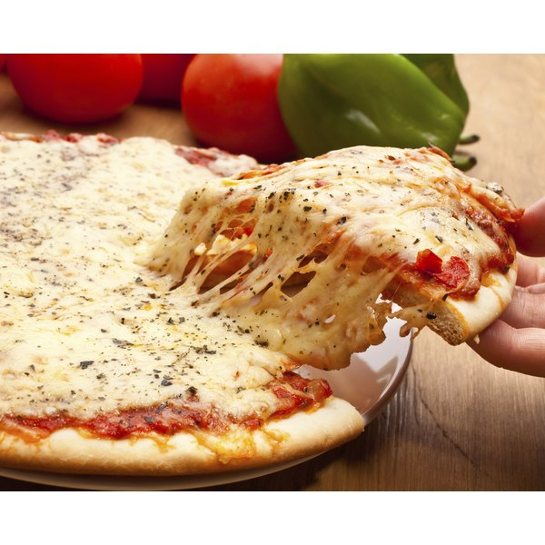 Hand taking a slice of cheese pizza.