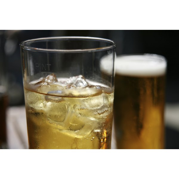 Close-up of iced cider in tall glass