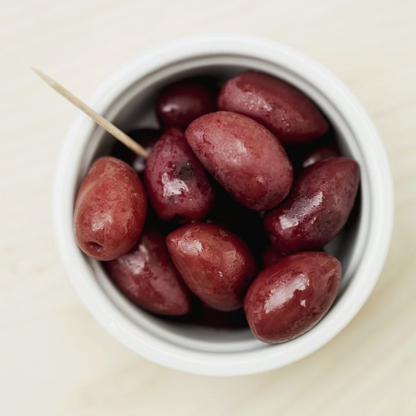 Close up, aerial view of a bowl of Kalamata olives.