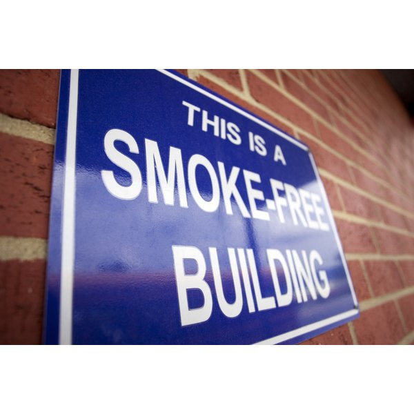 A blue sign on a building stating that the building is smoke free.