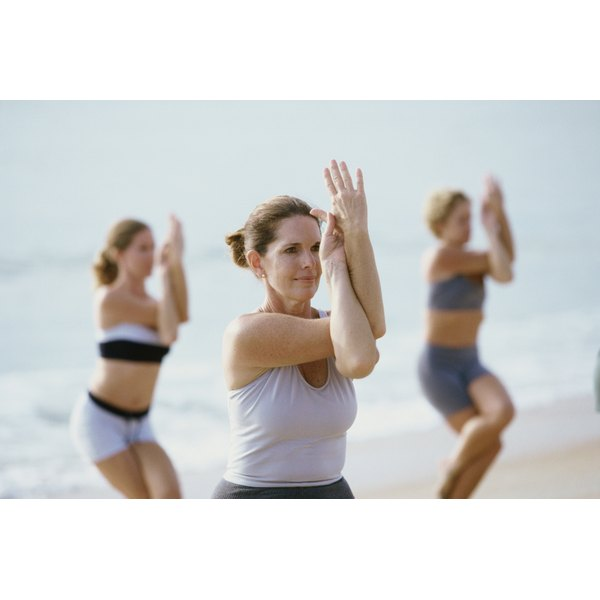 Women in an exercise class on the beach.
