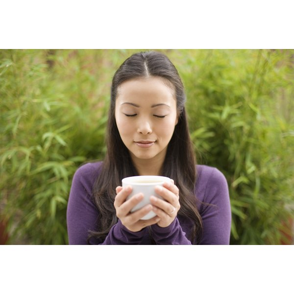 A woman relaxing with a cup of herbal tea.