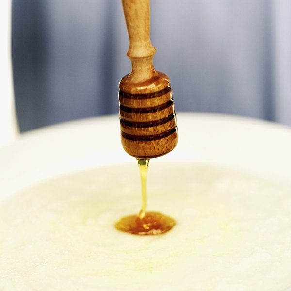 Close-up of raw honey being drizzled on cereal.