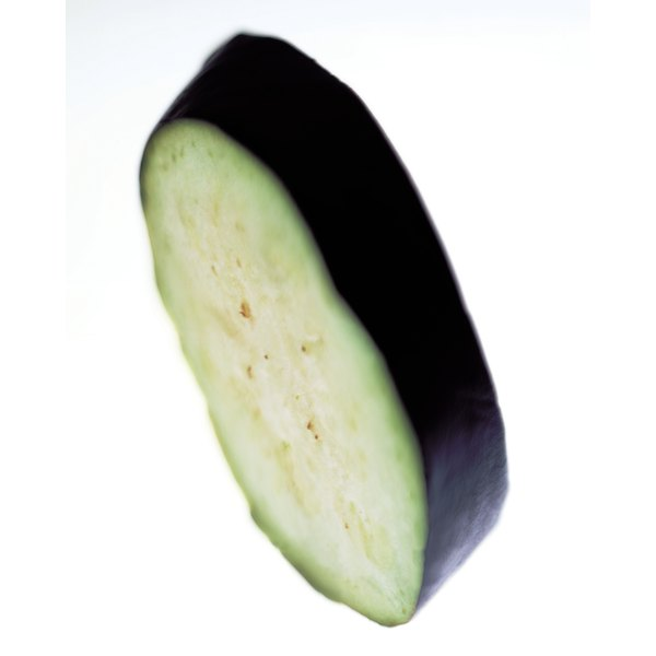 Dredging eggplant properly keeps too much moisture from reaching the slices.