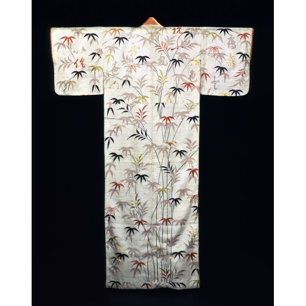 A kimono and obi are made from colorful silk with interesting patterns and a variety of colors.