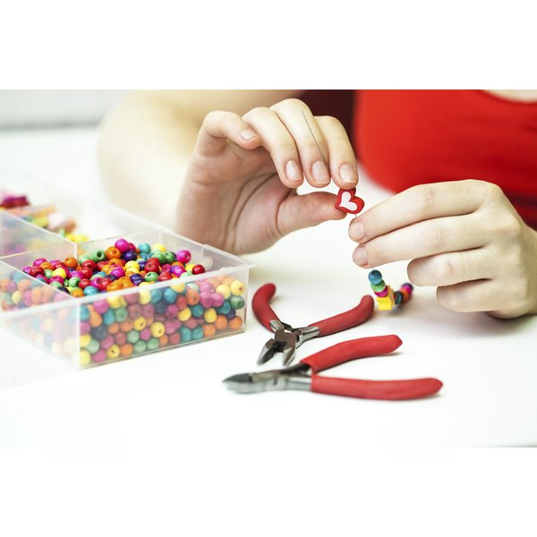 Tupperware containers filled beads