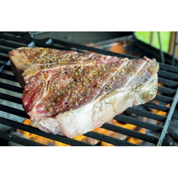 Close-up of a T-bone steak on the grill.