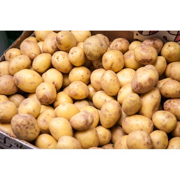 Potatoes for sale at a market stall.