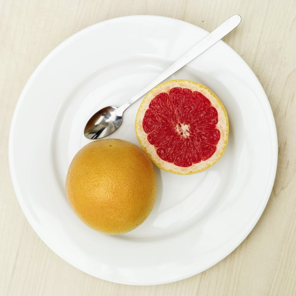 A halved grapefruit on a small plate.