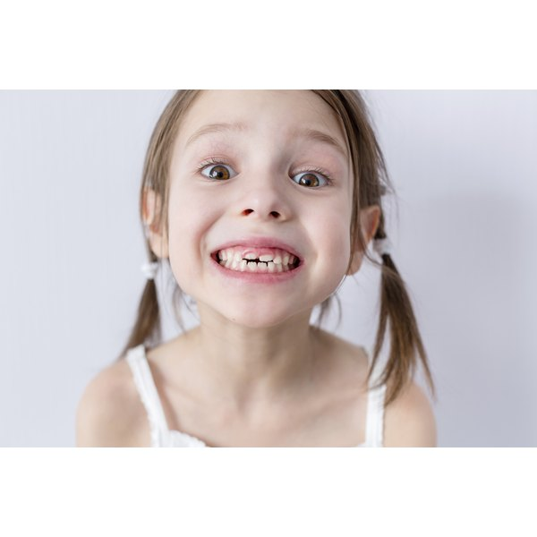 A young girl with new teeth growing in.