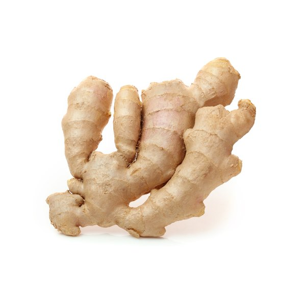 A bulb of ginger root sits on a white counter.