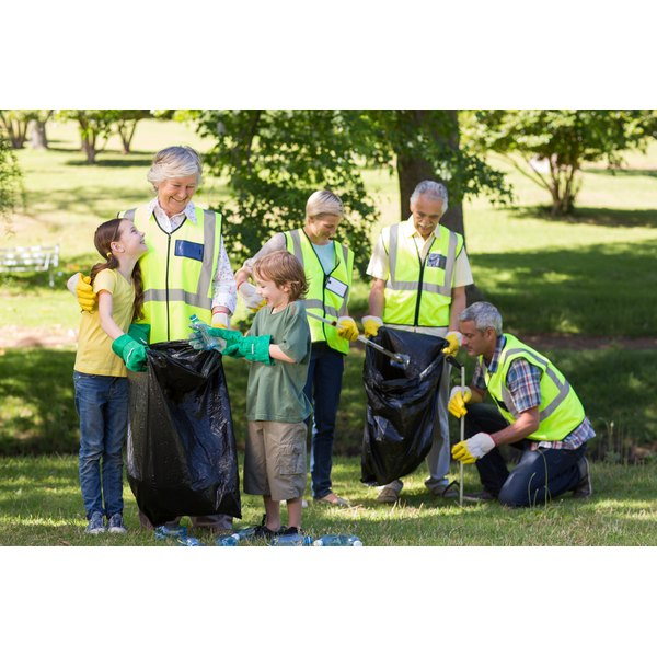 Kids help volunteer senior citizens clean up a park of all its trash.