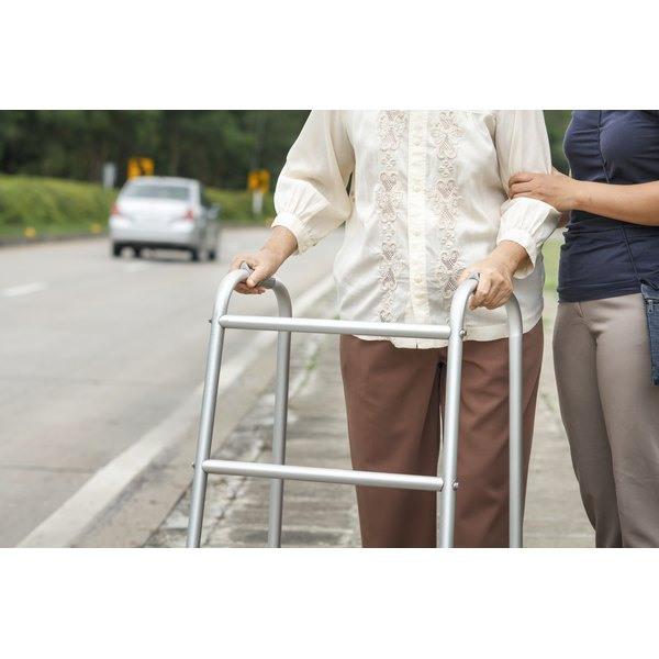 Woman helping a senior woman with a walker
