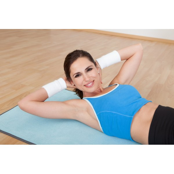 A woman is doing abdominal exercises.