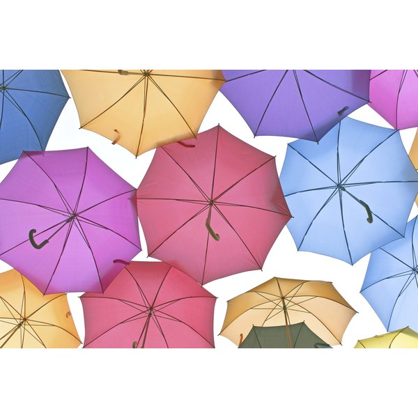 Turn plain umbrellas into decorative ones to match your shower.