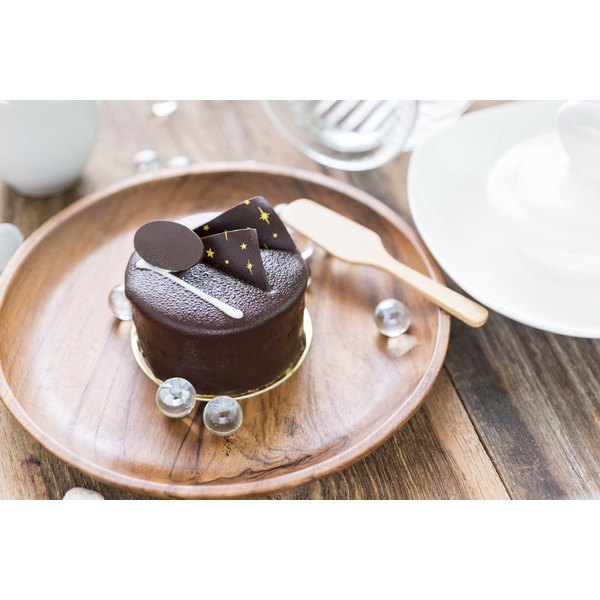 A dark chocolate cake on a plate.