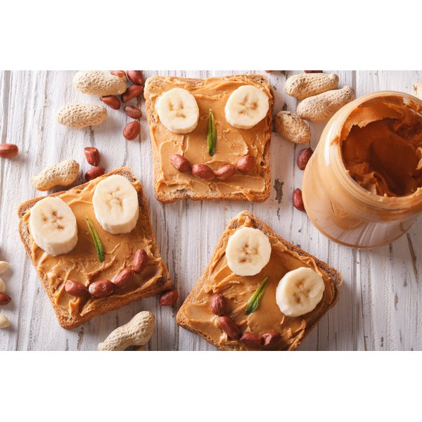 Peanut butter spread on top of slices of toast.