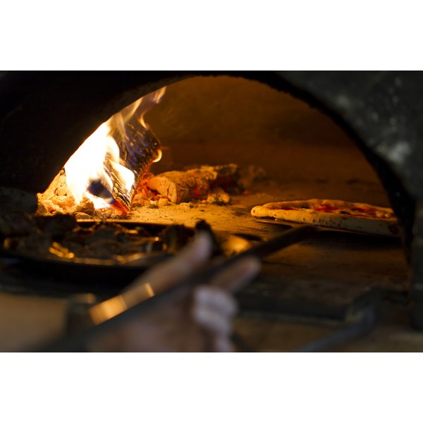 Cooking a wood Fired Pizza at an Italian Restaurant.