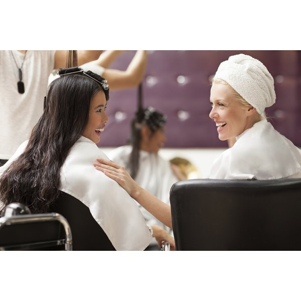Two women are at the salon.