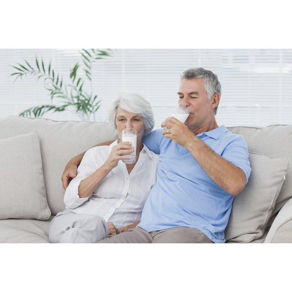 A man and his wife are drinking milk.