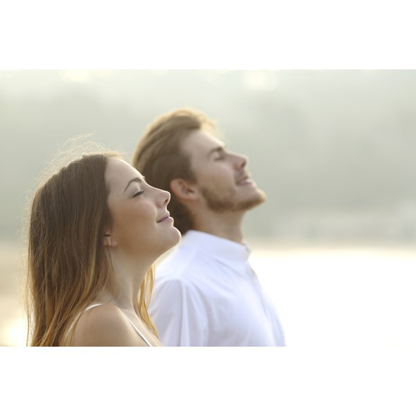 A couple breathing in fresh morning air.