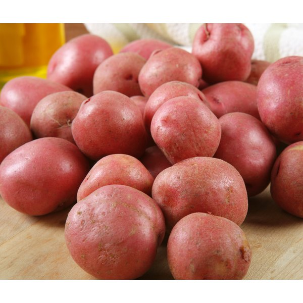 Pile of red skin potatoes on cutting board