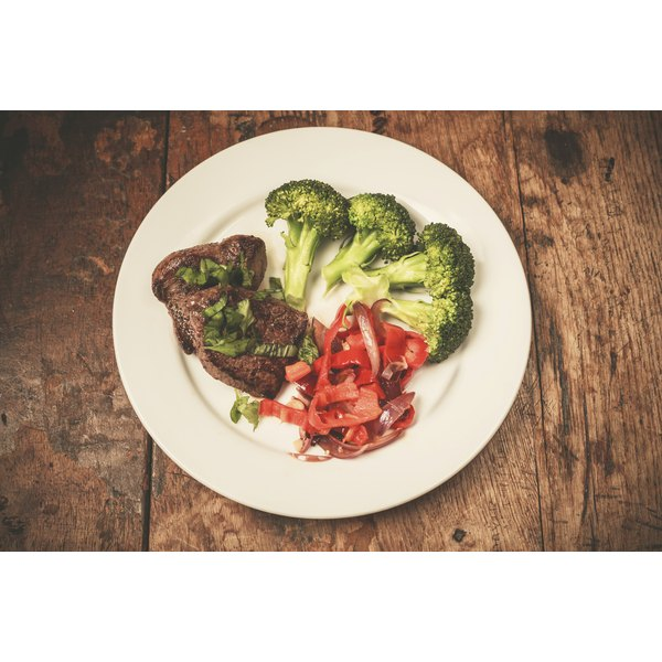 paleo food on plate on wood table in kitchen setting