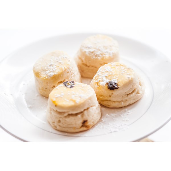 Tasty looking scones on a white plate.