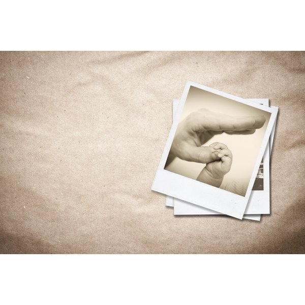 Sentimental polaroid photographs on crumpled brown paper.
