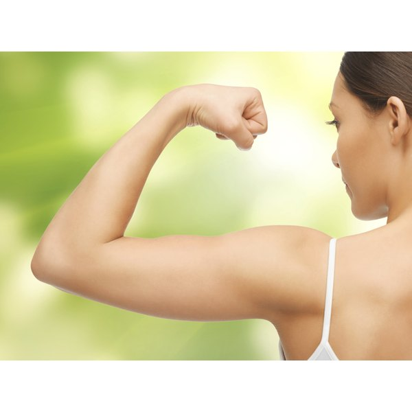 woman flexing arm muscle