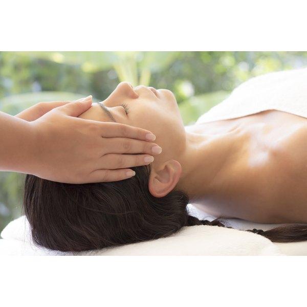 A woman receiving a facial massage at a spa.