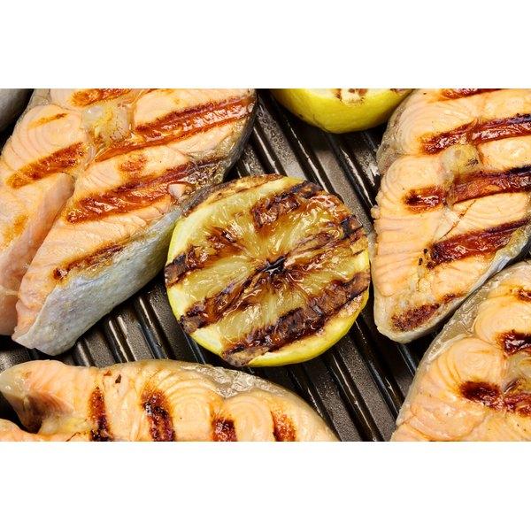 Pan fried salmon and lemons.